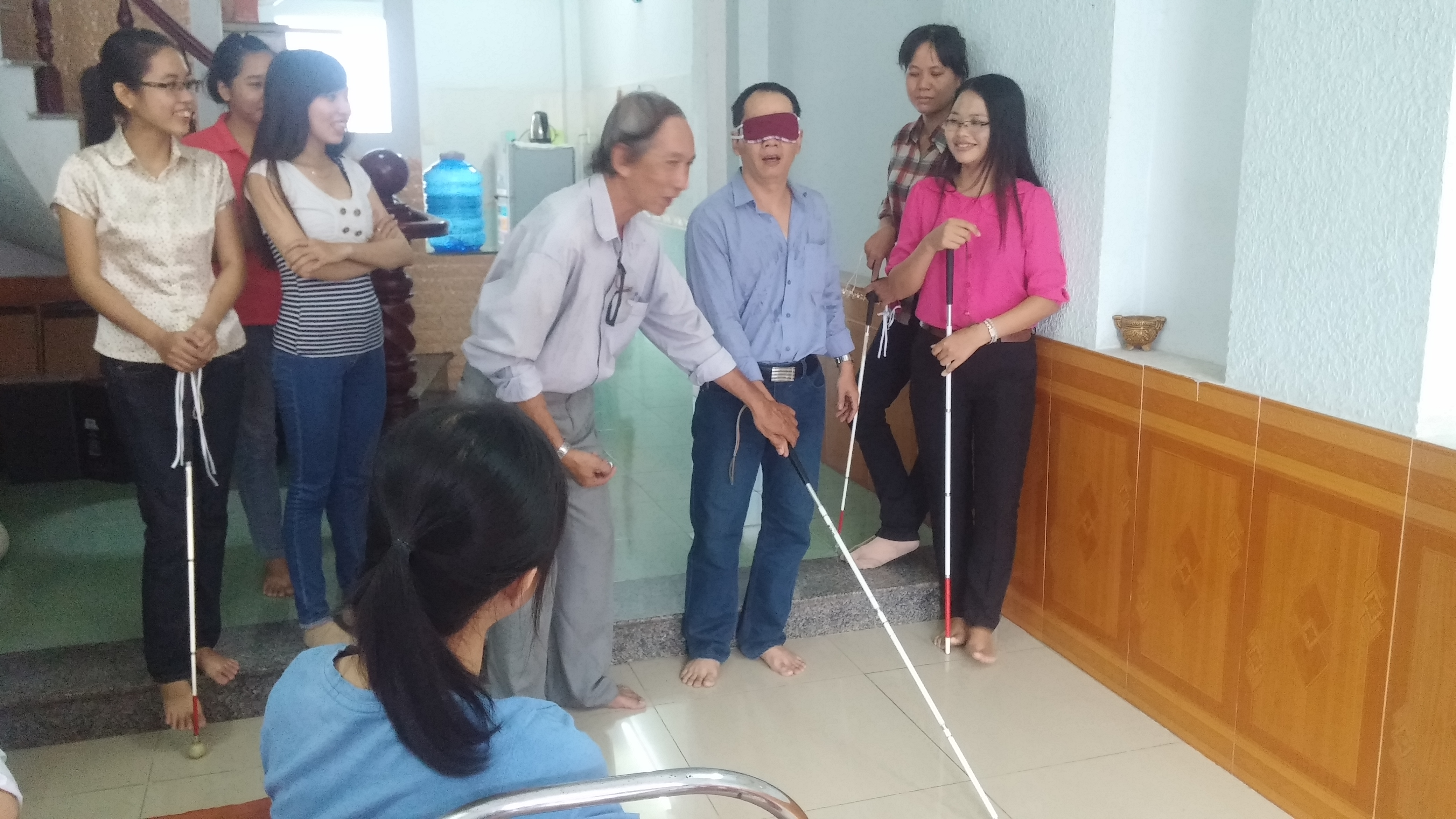 A session to train Orientation and Mobility Skills for volunteers at Sao Mai