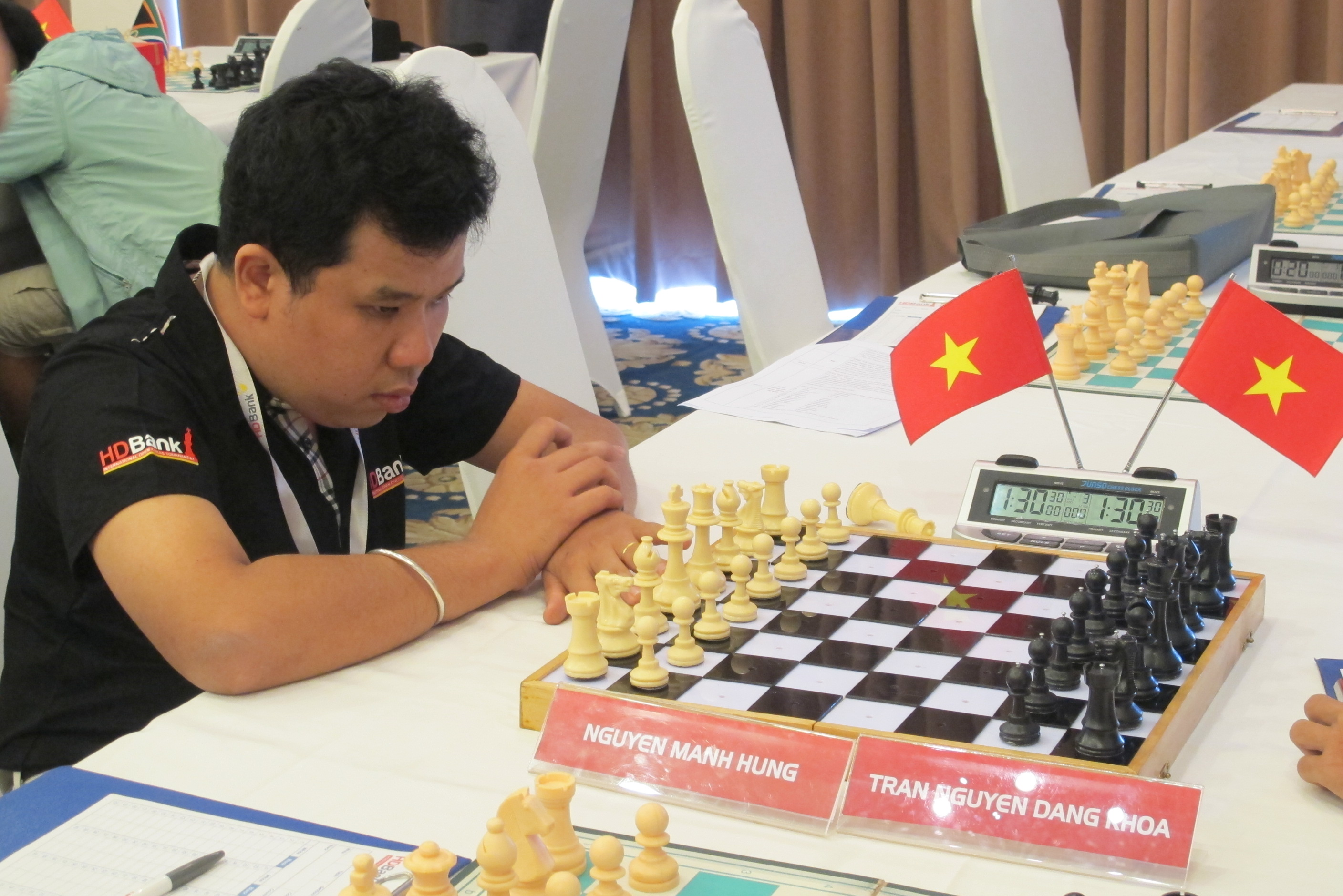 Nguyen Manh Hung competes in the HDBank international open chess tournament