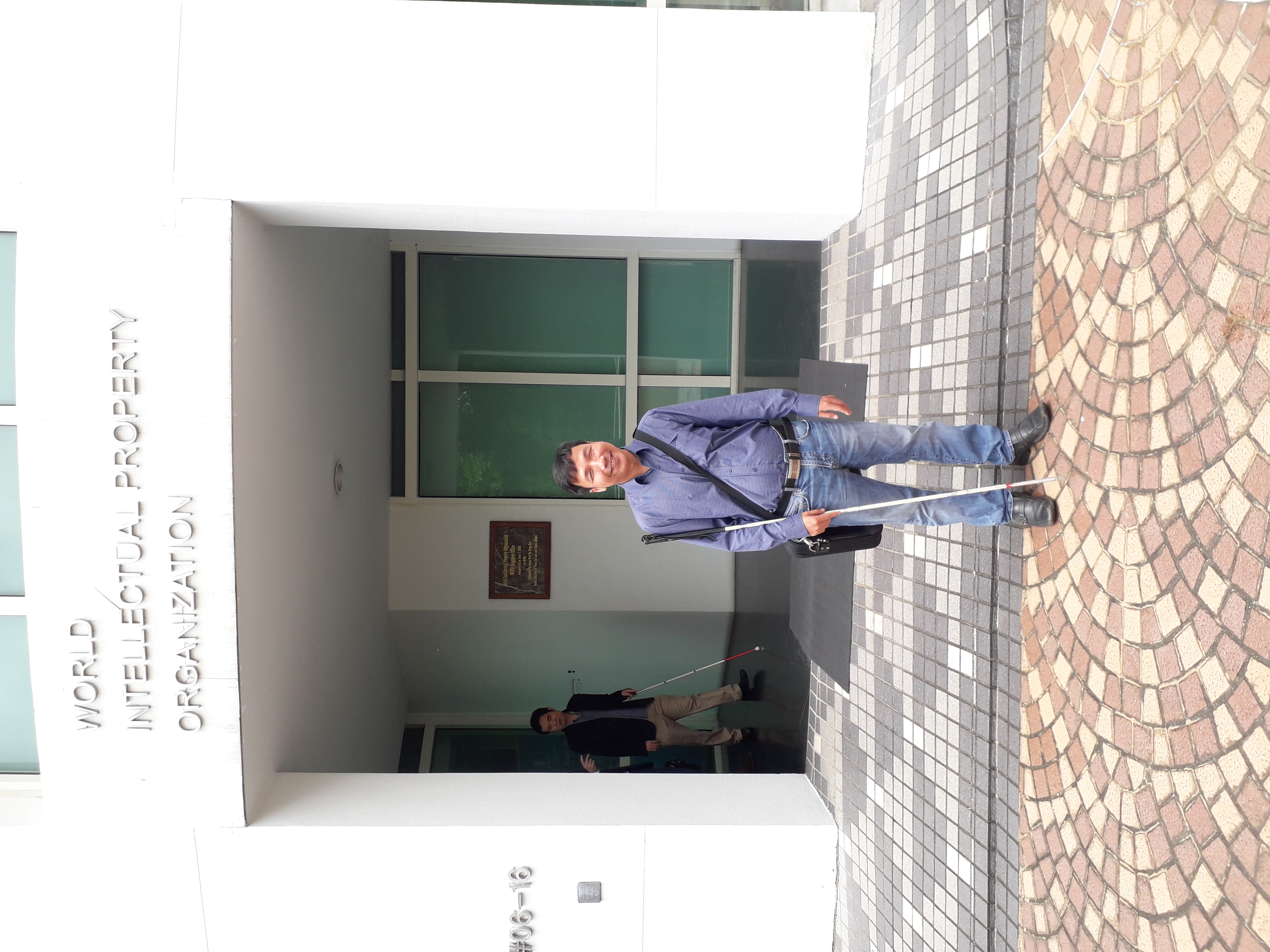 Mr. Phuc in front of Singapore WIPO office